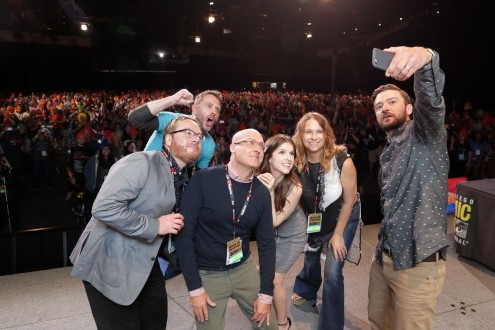 TROLLS filmakers and voice actors take a selfie with the audience at DreamWorks Animation's Comic Con Hall H Panel. (from left) Co-Director Walt Dorn, Moderator Chris Hardwick, Director Mike Mitchell, Anna Kendrick, Producer Gina Shay, and Justin Timberlake.