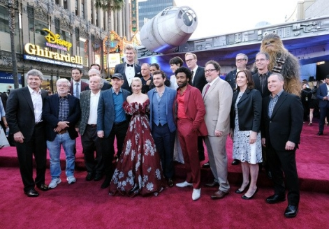 "HOLLYWOOD, CA. Cast and crew of ""Solo: A Star Wars Story"" attend the world premiere of ""Solo: A Star Wars Story"" in Hollywood on May 10, 2018. (Photo by Alberto E. Rodriguez/Getty Images for Disney) Alan Horn; George Lucas; Clint Howard; Jonathan Kasdan; John Powell; John Williams; Joonas Suotamo; Ron Howard; Woody Harrelson; Emilia Clarke; Thandie Newton; Phoebe Waller-Bridge; Alden Ehrenreich; Donald Glover; Paul Bettany; Jon Favreau; Kathleen Kennedy; Simon Emanuel; Jason McGatlin; Alan Bergman"